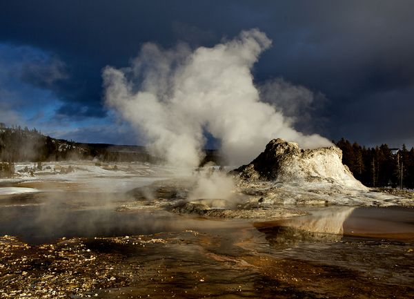 Steam rises from Castle Geyser in Yellowstone National Park (file photo). Photograph by Mark Thiessen, National Geographic